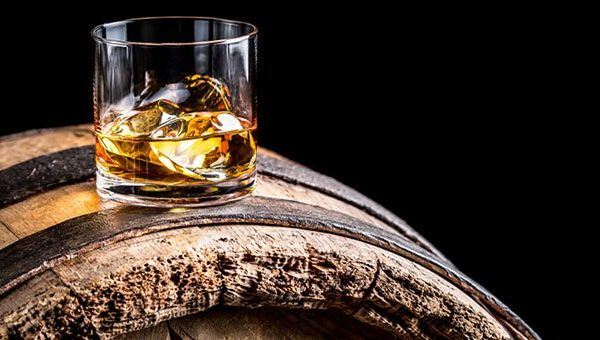 whiskey in a rocks glass on top of a barrel.jpg.660x0_q85